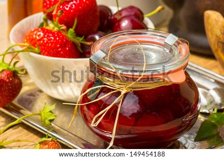Hand-made cherry-strawberry confiture with Amaretto  - stock photo