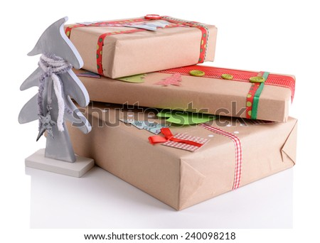 Hand-made Christmas gifts isolated on white