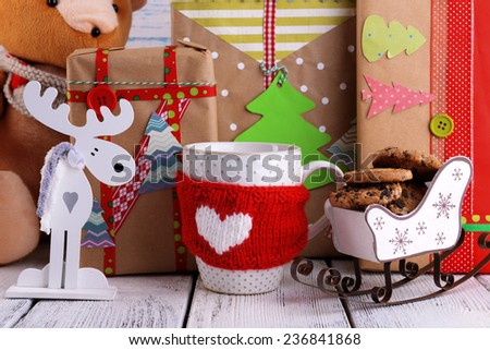 Hand-made Christmas gifts with decorations on wooden background - stock photo