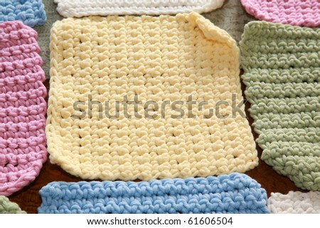 hand made crochet squares and yarn ready to be sewn into a baby blanket - stock photo