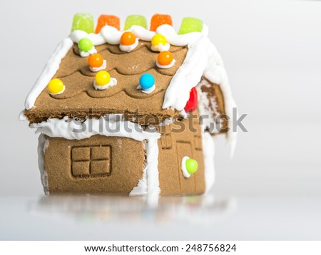 hand made gingerbread house on white background - stock photo
