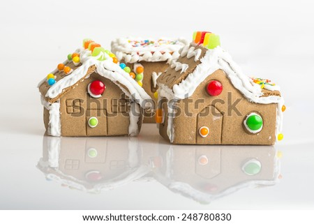 hand made gingerbread houses on white background - stock photo