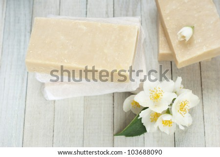 hand made jasmine soaps with white jasmine flowers on wooden background