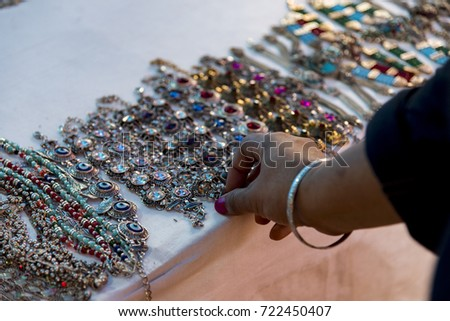 Hand made jewelries for sale at a shop in New Delhi, India. The crafts of India are diverse, rich in history and religion. The craft of each state in India reflect the influence of different empires.