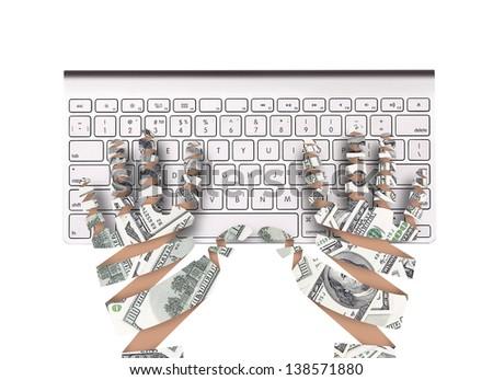 Hand made of dollar bank notes and keyboard - stock photo