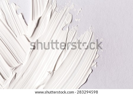 Hand made oil paint brush stroke over the white paper as a design element of a backdrop - stock photo