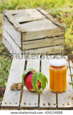 hand made peach marmalade on wooden crate - stock photo