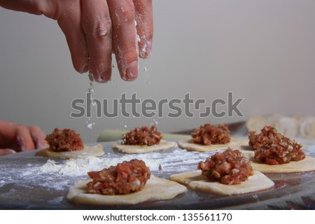 hand made ravioli getting prepared on table