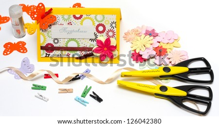 hand made scrapbooking post card and tools lying on a white background - stock photo