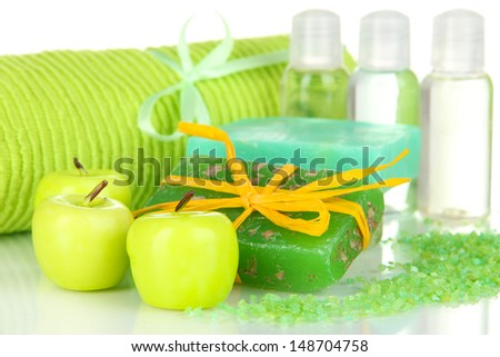 Hand made soap and aroma candles isolated on white - stock photo