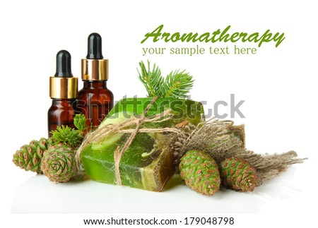 Hand-made soap and bottles of fir tree oil, isolated on white - stock photo