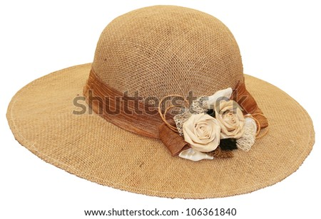Hand-made straw hat decorated with dried flowers