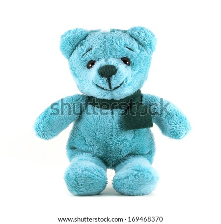 Hand made TEDDY BEAR blue color with scarf on white background - stock photo