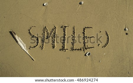 Hand made text in sand on a beach - Sun and Sea