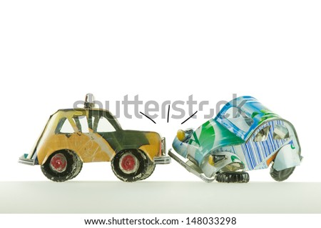 hand made toys cars having an accident - stock photo
