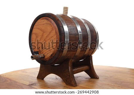 hand made wooden barrel full whiskey with crane over wooden table isolated over white background - stock photo