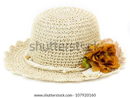 Hand made woven hat with flower - stock photo