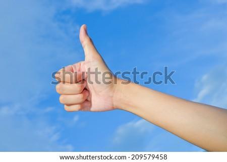 hand make thumbs up blue sky - stock photo