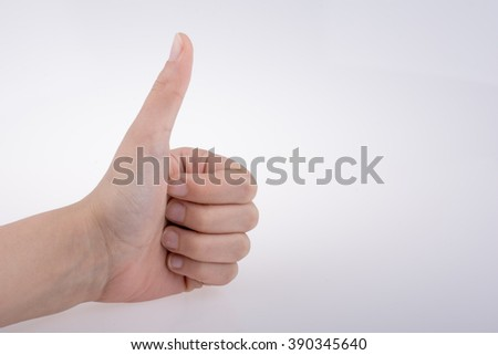 Hand making a good gesture on a white background