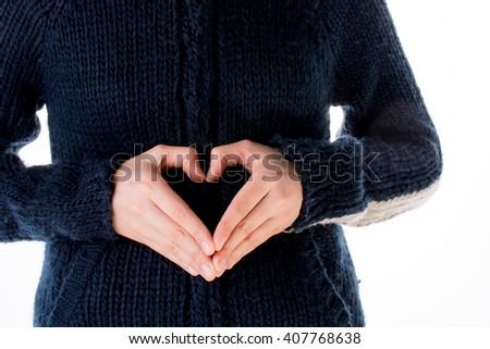 Hand making a heart on a white background