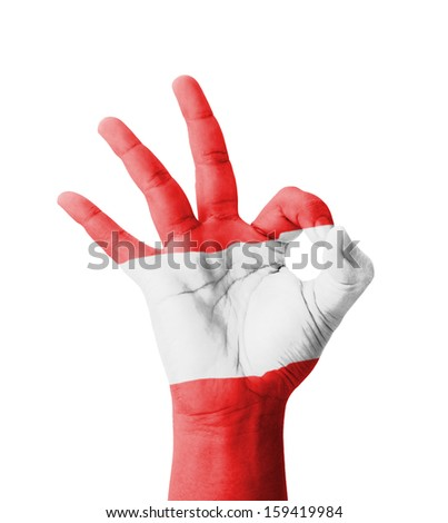 Hand making Ok sign, Austria flag painted as symbol of best quality, positivity and success - isolated on white background
