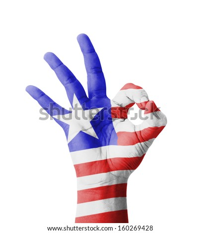 Hand making Ok sign, Liberia flag painted as symbol of best quality, positivity and success - isolated on white background