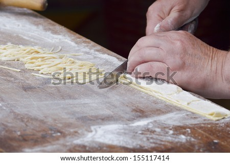 Hand making pasta - stock photo