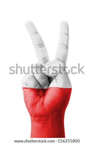Hand making the V sign, Poland flag painted as symbol of victory, win, success - isolated on white background - stock photo
