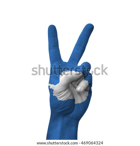 Hand making victory sign, antarctica painted with flag as symbol of victory, win, success - isolated on white background