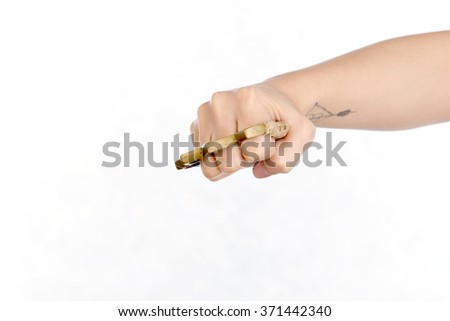 Hand man wearing brass knuckles on white background.Knuckle weapons