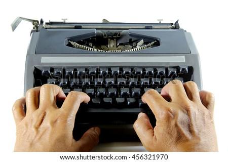 Hand man writing on a typewriter - stock photo
