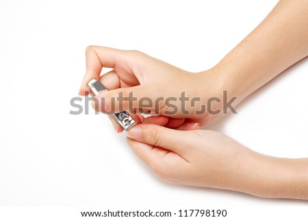 hand manicure with nail clipper - stock photo