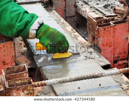 hand masons working on the construction site - stock photo