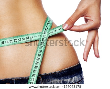 Hand measuring waist - stock photo