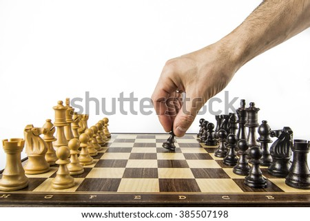 hand moving a chess piece - stock photo