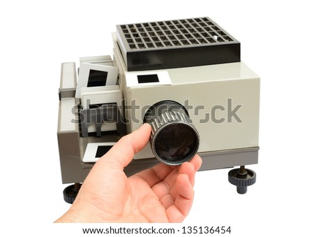 hand moving and adjust lens focus slide projector