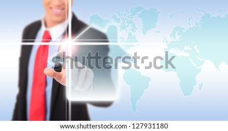 Hand of a business man pressing home symbol on world map