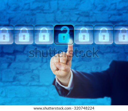 Hand of a business person is unlocking an information packet in a data stream. Technology concept for computer crime, cyberattack, cyber theft, white collar crime, cyberwarfare and industrial spying. - stock photo