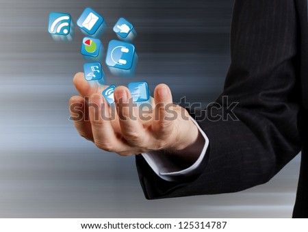 hand of a businessman and icons