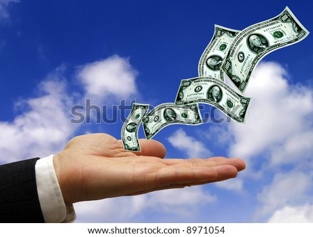 hand of a businessman open with dollars banknotes flying from it