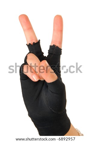 "hand of a girl in black glove is showing sign that means ""victory!"" - stock photo"