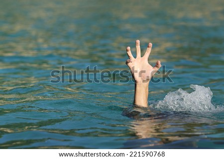 stock-photo-hand-of-a-man-drowning-in-th