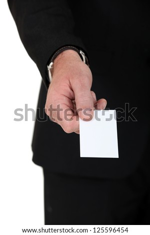 Hand of a man giving business card - stock photo