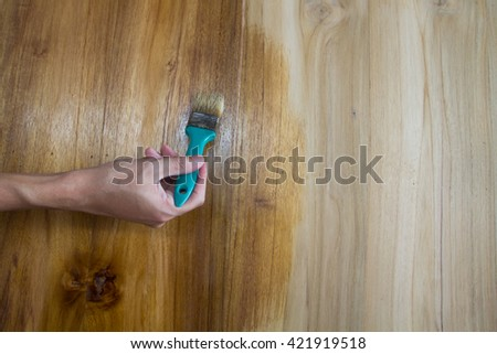 hand of a man paint on wooden furniture , D.I.Y Concept - stock photo