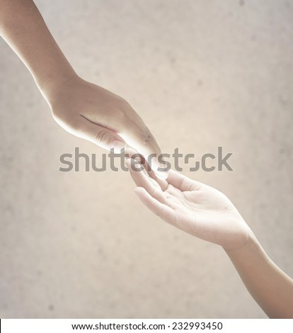 Hand of a man reaching to hand of GOD. World Mental Health Day concept. - stock photo