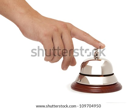 Hand of a man using a hotel bell isolated