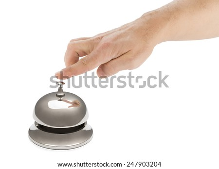 Hand of a man using hotel bell with reflection isolated on white background. - stock photo