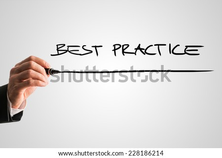 Hand of a man writing Best practice on a virtual screen with a marker pen with copyspace below. - stock photo