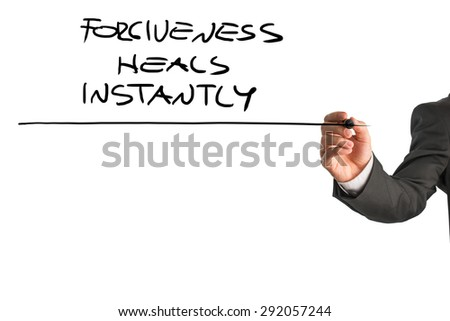 Hand of a professional therapist writing a Forgiveness heals instantly saying on a white virtual screen. Suitable for mental health and personal growth concepts. - stock photo