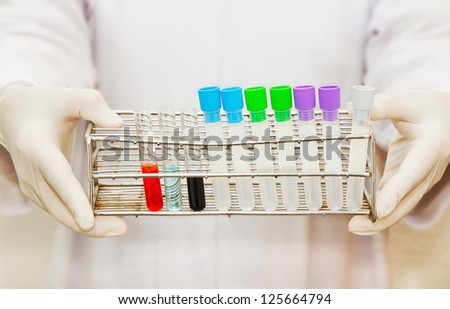 hand of a scientific  holding a tube test - stock photo
